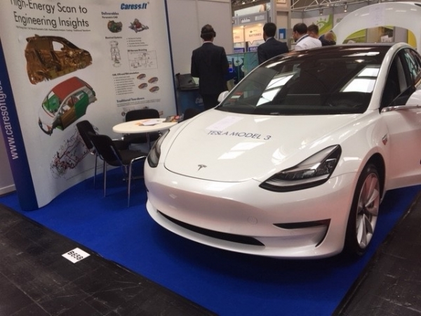 Tesla Model 3 at the booth of supplier Caresoft.
